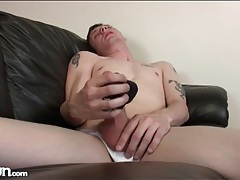 Tall skinny guy jerks off and cums on his soccer ball tubes