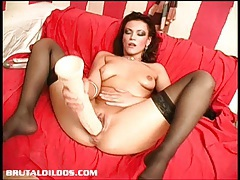Ella's tight pussy lips grip onto a giant brutal dildo tubes