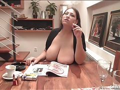 Chubby girl smokes with her big natural tits out tubes