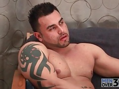 Masturbating muscular guy cums on his stomach tubes