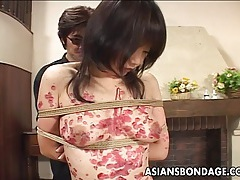 Alluring asian gal punished with hot wax tubes