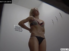 Young czech girl fitting bra and panties in lingerie store tubes