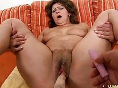 Dildo machine fucks deep into hairy pussy tubes