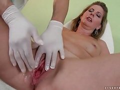 Doctor takes her anal temperature and fingers her tubes