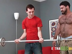 Gorgeous bear seduces a skinny guy tubes