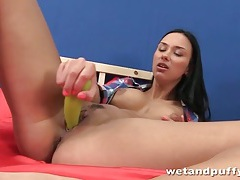 Brunette fucks a veggie and opens her pussy tubes