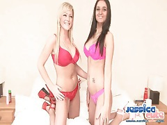 Two chicks in bras and panties strip and fondle tubes