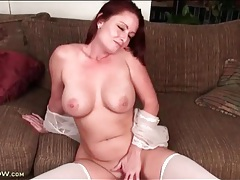 Sexy milf redhead with lovely curves fucks toy tubes