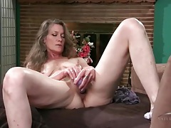 Hairy mature vibrates her pussy with a toy tubes