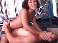 Asian girl demonstrates wrestling moves on him tubes