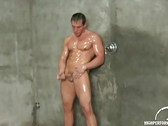 Muscular guy showers and masturbates dick tubes