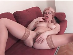 Mature blonde strips nude and toys her pussy tubes
