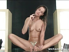 Sexy body brunette plays with her hot piss tubes
