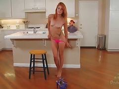 Redhead in a pink dress does a sexy striptease tubes