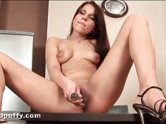 Lovely girl in high heels masturbates with a toy tubes