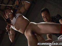 Enticing japanese hottie pounded with a dildo tubes
