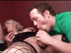 Shemale blonde in boots blows two guys tubes
