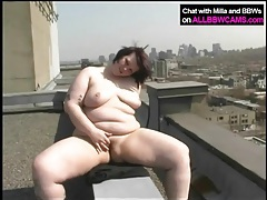 Fat girl on a rooftop masturbates her pussy tubes