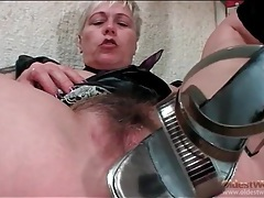 Blonde mature fucks cunt with her high heels tubes