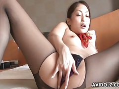 Japanese girl in ripped pantyhose vibrated tubes