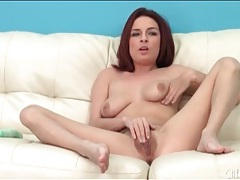 Cute redhead has solo sex with a toy tubes