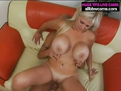 Blonde mom with fake breasts sits on dick tubes