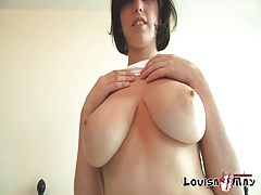 Cutie lifts her shirt to show off her big tits tubes