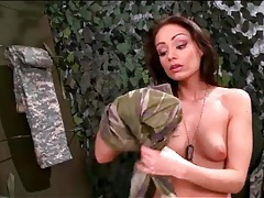 Brunette army girl rubs her feet on her pussy tubes