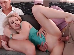Hot blonde with fake tits blows two guys tubes