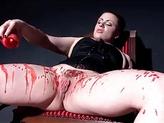 Kinky chick in corset pours hot wax on her body tubes