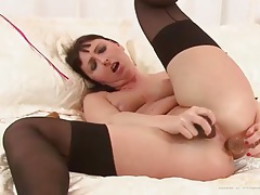 Mom in seamed stockings toys her asshole tubes