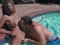 Naked busty babe gets her tits sucked in the pool tubes