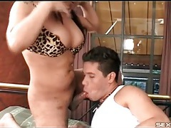 Shemale spits on and licks his smooth ass tubes