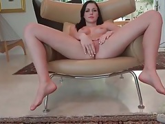 Angelic brunette naked and rubbing shaved cunt tubes