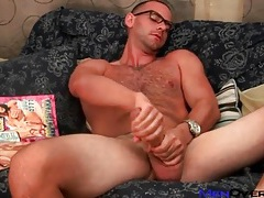 Hot hairy guy in glasses strokes big cock tubes