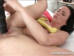 Young cunt stretches around big black dildo tubes
