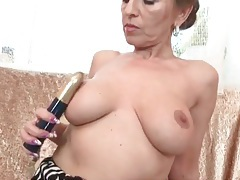 Milf with splendid big tits fingers her cunt tubes
