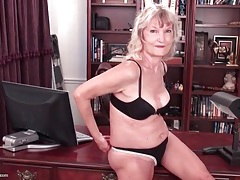 Granny striptease in her office tubes