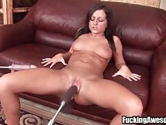 Dildo machine fucks her bald pussy deep tubes