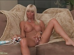 Tanned bimbo milf strips to model her titties tubes