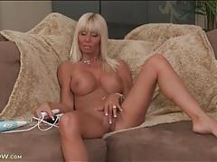 Tanned bimbo milf strips to model her titties tubes