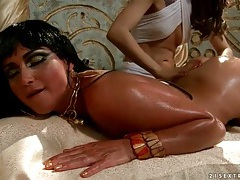 Beautiful girl oiled up by her sexy servant tubes