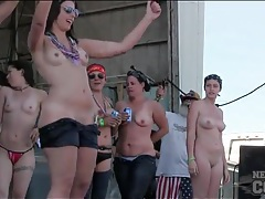 Roadies pour water on topless dancing girls tubes