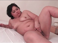 Chubby solo girl gently rubs her cunt tubes