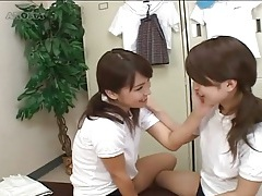 Pigtailed japanese teens kiss in locker room tubes