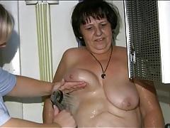 Nurse helps fat granny take a shower tubes