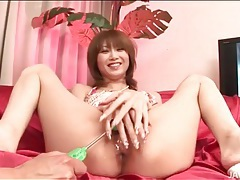 Cumshot lands on her cute japanese tongue tubes