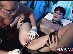 Kinky lesbian medical fetish play with latex tubes