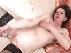 Mature with perky fake tits fucks a toy tubes