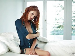 Gorgeous redhead strips and tenderly masturbates tubes